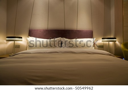 double bed at night - stock photo