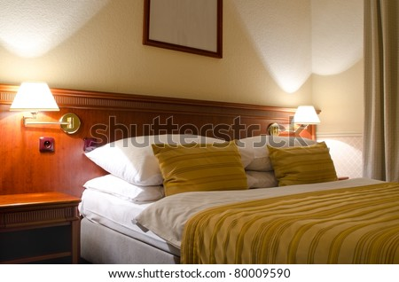 Double bed hotel room - stock photo