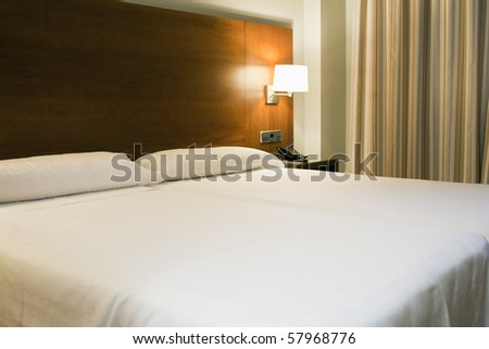 Double bed in a confortable hotel room - stock photo