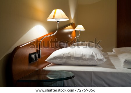 Double bed in the comfortable hotel room - stock photo