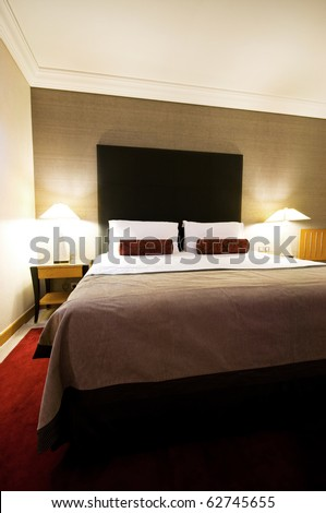 Double bed in the hotel room - stock photo