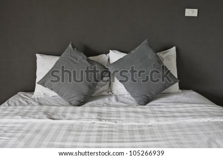 Double bed in the interior. - stock photo