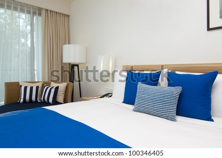 Double bed in the modern interior bedroom - stock photo