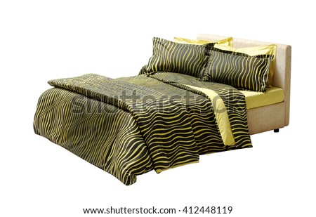 double bed isolated on white with animal print pattern black and yellow covers - stock photo