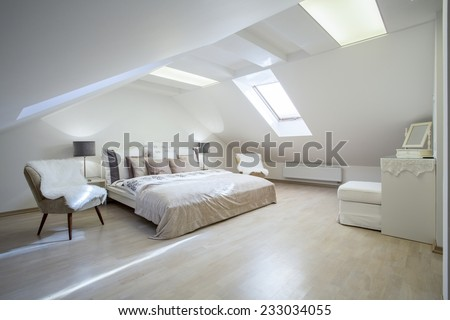 Double bed with a lot of cushions in luxury apartment - stock photo