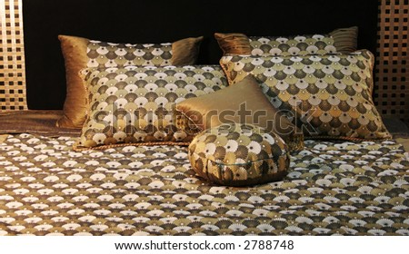 Double bed with beautiful linen - home interiors - stock photo