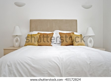 double bed with bedside tables and reading lamp - stock photo
