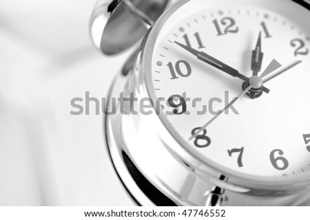 Double bell alarm clock isolated on a white background.