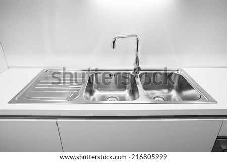 Double bowl stainless steel kitchen sink - stock photo