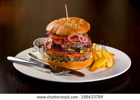 double burger with chips - stock photo