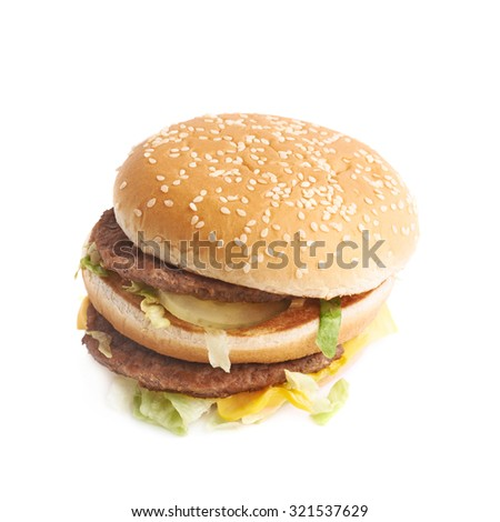 Double burger with pickles and lettuce isolated over the white background