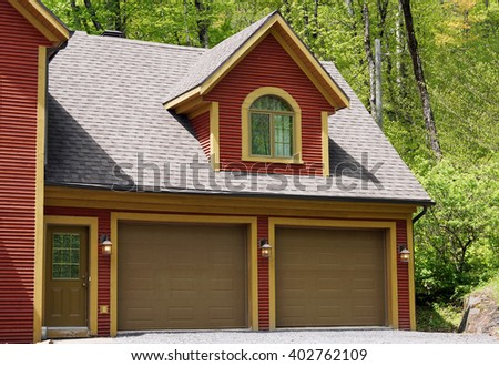 Double car garage of a house in the country - stock photo