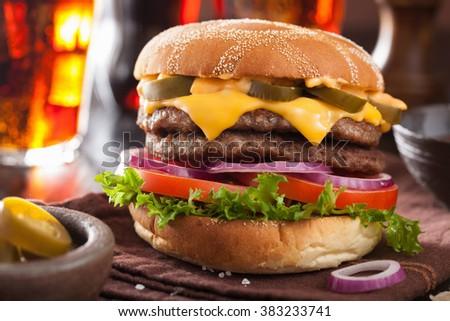 double cheese burger with jalapeno tomato onion - stock photo