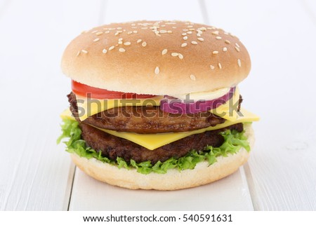 Double cheeseburger hamburger tomatoes lettuce cheese wooden board wood