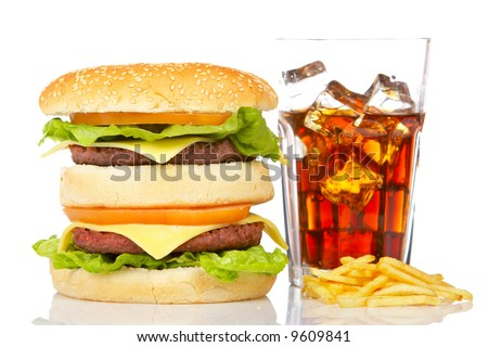 Double cheeseburger, soda drink and french fries, reflected on white background. Shallow DOF