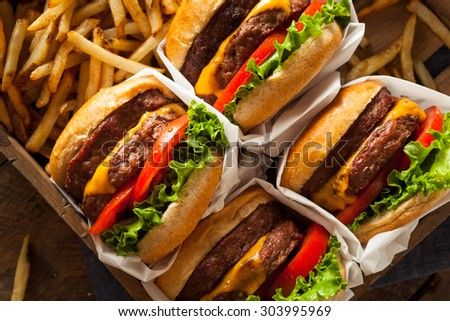 Double Cheeseburgers and French Fries in a Tray - stock photo