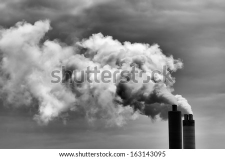 double chimney exhausting lots of dirty smoke - stock photo