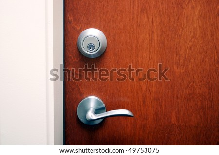 Double deadlocked brown wooden door. - stock photo