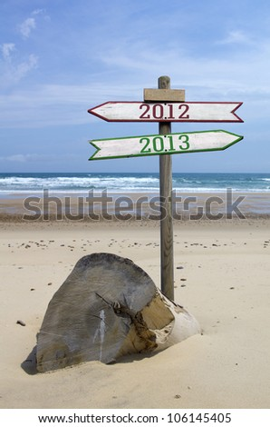 Double directional signs on a beach 2012 to 2013 - stock photo
