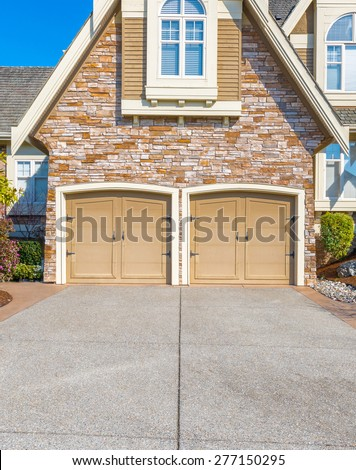 Double doors garage and long driveway. North America.