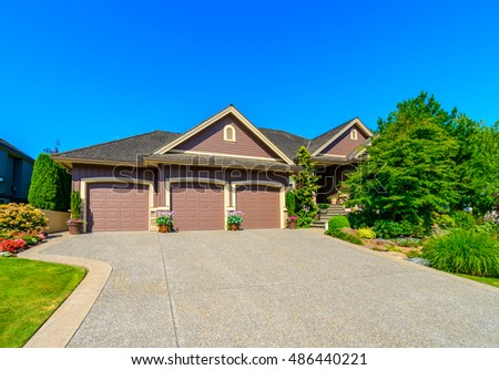 Double doors garage with wide long driveway.