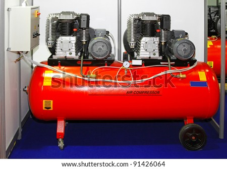 Double engine air compressor in service garage - stock photo
