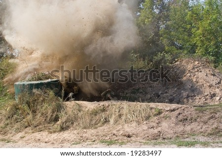 Double explosion on a battle-field. - stock photo