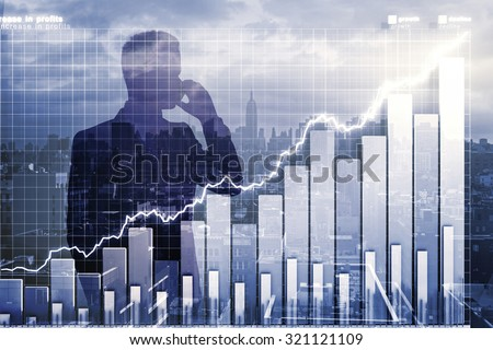 Double explosure with businessman talking by phone and business chart