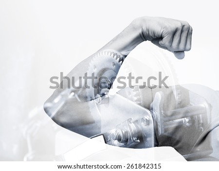 Double exposure abstract conceptual power photo collage, strong male hand showing  biceps and industrial mechanism background
