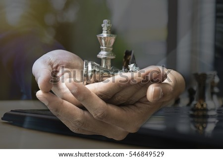 double exposure business man leader of a successful business holding the chess in hand