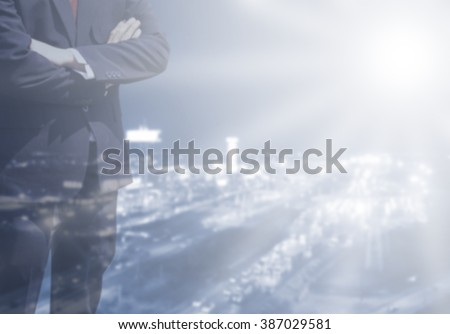 Double exposure Business man success or soft Business man success in he working on marketing online or e learning with global learning on over blurred top city view with light flare from corner.  - stock photo