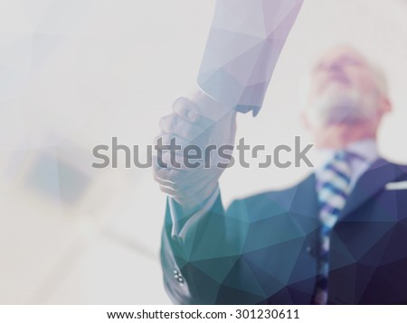 Double exposure design. Business partners, partnership concept with two businessman handshake - stock photo