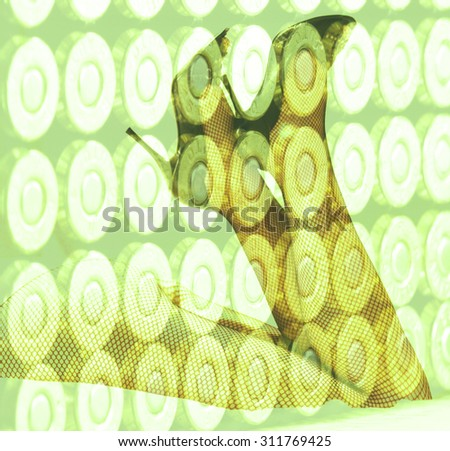 Double exposure female legs and high heels with ammunition bullets background - stock photo