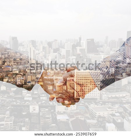 Double exposure handshake - stock photo