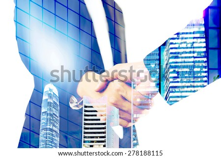 double exposure handshake on a city background - stock photo