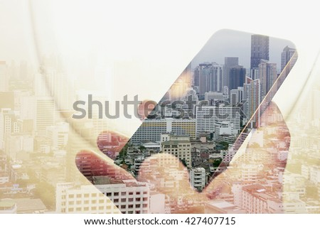 Double exposure image of businessman sitting in the airplane and using smart phone with cityscape background, Business technology concept.