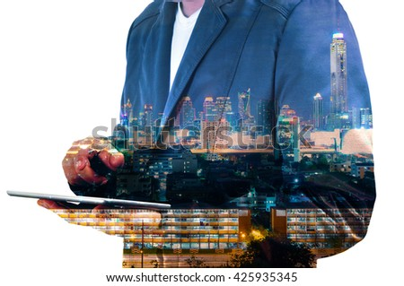 Double Exposure image of Businessman use Digital Tablet and City Building at Twilight - stock photo