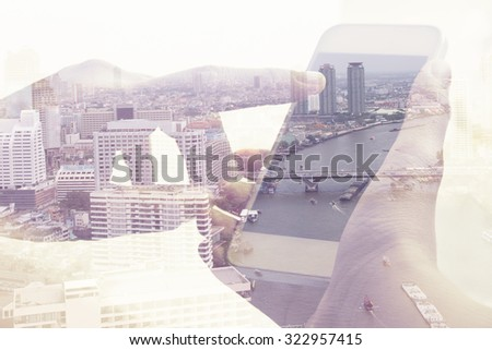 Double exposure image of people with smart phone and cityscape background,Business technology concept.