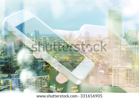 Double exposure image of people with smart phone and cityscape background. communication technology concept.