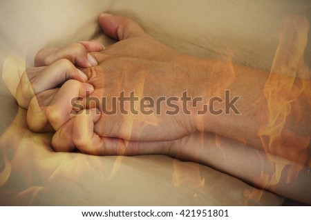Double exposure of a couple hand having hot sex and fire on a bed, Hot sex erotic concept