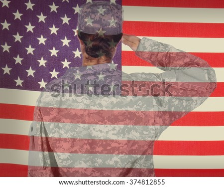 Double exposure of a female soldier saluting an American flag.  - stock photo