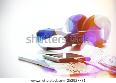 double exposure of abstract blurry bokeh with smart phone with headphone on musical notes paper with shallow DOF evenly matched - stock photo