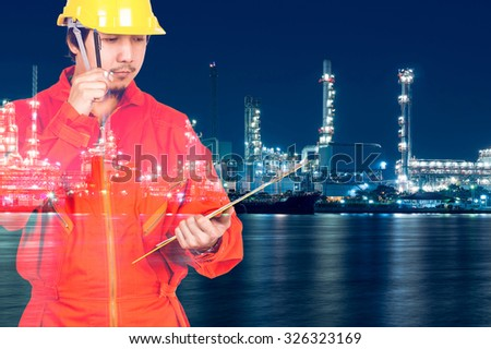 Double exposure of Asian engineers thinking and holding the note pad on Oil and gas refinery or Petrochemical factory at twilight time, industrial concept - stock photo