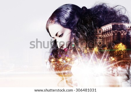 Double exposure of beautiful girl and  city lights at night - stock photo