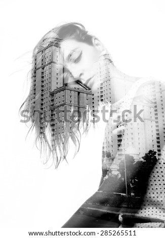 Double exposure of beautiful girl and modern buildings - stock photo