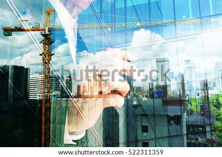 Double exposure of business engineer and abstract city as Construction industrial concept