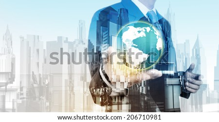 Double exposure of business engineer holding the earth and abstract city as concept - stock photo