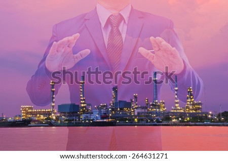 Double exposure of business man and oil refinery background  - stock photo
