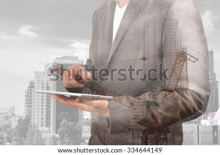 Double exposure of Business Man and Power Crane in the City as Construcition Project concept. - stock photo