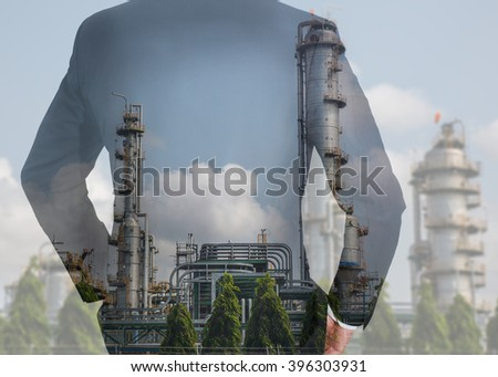 Double exposure of business man Back, looking ahead and Electric Generating Factory as Energy and Technology concept.